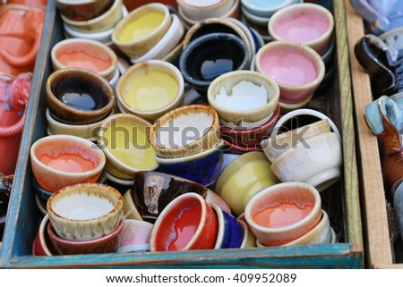ceramic small and colorful tea cup background, ceramic products and industry in Thailand - stock photo