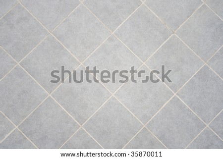 Ceramic tile background. Close-up of newly installed tile with natural colored grout. - stock photo