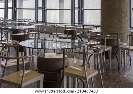 chairs and tables in the restaurant - stock photo