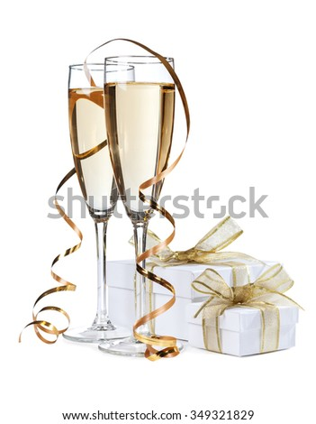 Champagne and streamers with a gift box isolated - stock photo