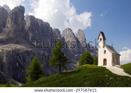 Chapel with mountain view in the background, Passo Gardena, Dolomite Mountains, Italy - stock photo