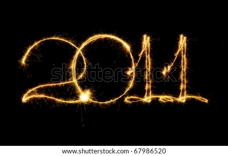 2011 character made of sparks isolated on the black - stock photo