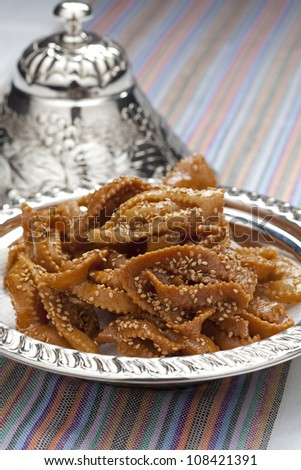 Chebakia honey cookies with sesame seeds in a metal bowl  made for the time of ramadan - stock photo