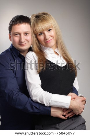 cheerful family couple embrace blond woman - stock photo