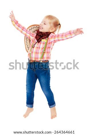 Cheerful girl in clothes cowboy jumps for joy - isolated on white background - stock photo
