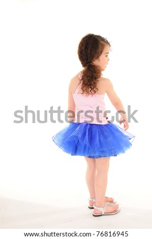 Cheerful girl wearing dress isolated on white .Back to the camera - stock photo