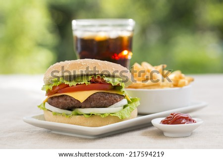 Cheeseburger with french fries and fresh drink - stock photo
