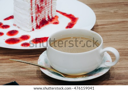 Cheesecake with Strawberries Sauce  and coffee