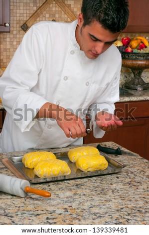Chef making beef Wellington - stock photo