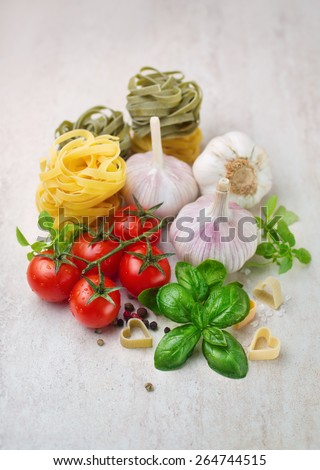 Cherry tomatoes and spices, ingredients for cooking pasta - stock photo