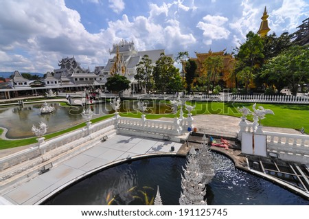 Chiang Rai, Thailand -  November 20,2012 : Wat Rong Khun, beautiful scene of Wat Rong Khun or the White Temple. some travelers are just sightseeing, some taking photography for good memory.