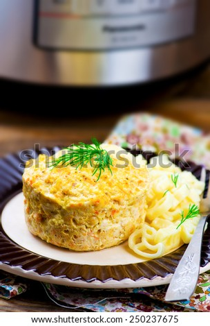chicken souffle prepared in the crock-pot and macaroni on a plate. selective focus - stock photo