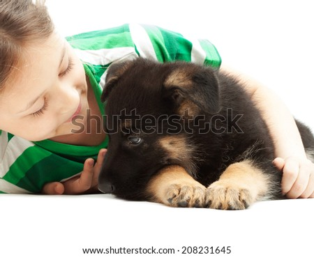 child  gently hugs puppy - stock photo