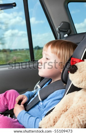 child in car seat - stock photo