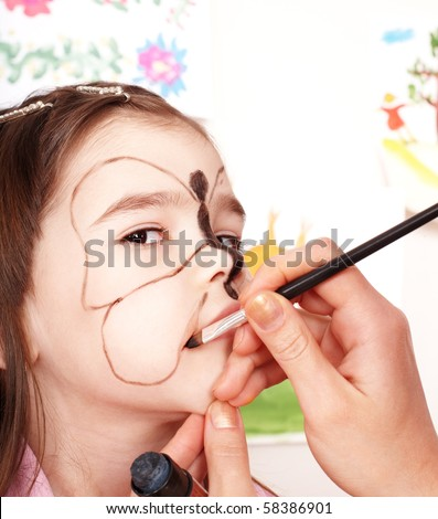 Child with face painting. Make up. - stock photo