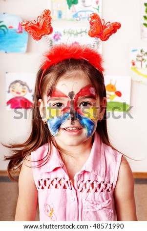 Child with paint of face. Make up.