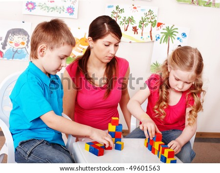 Child with wood block  in play room. Preschool. - stock photo