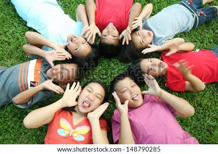 7 children having good time in the park.  - stock photo