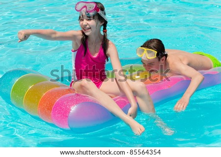 Children playing in pool - stock photo