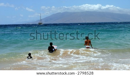 3  childs doing surf - stock photo
