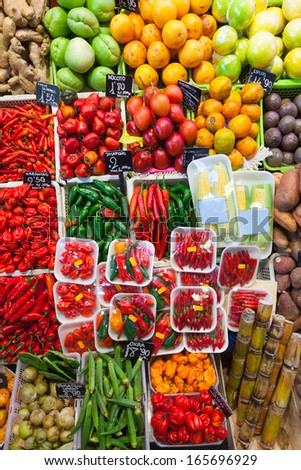 chili pepper and other vegetables on spanish market  - stock photo