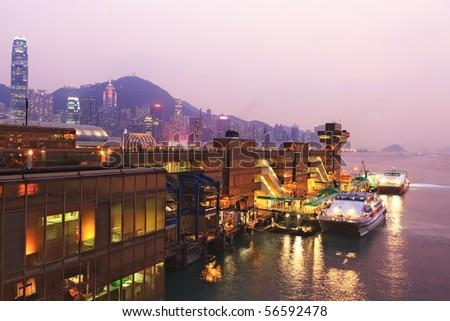 China Hong Kong harbor ferry at night time - stock photo
