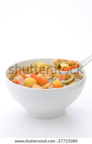 Chinese chicken soup with potatoes and peppers - stock photo