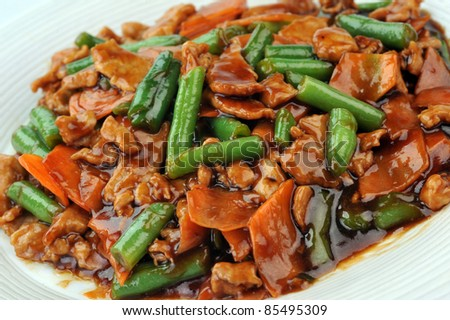 chinese cuisine. deep fried chicken with red sauce and beans - stock photo