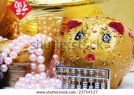 chinese gold ingots and coin ,piggy bank - stock photo