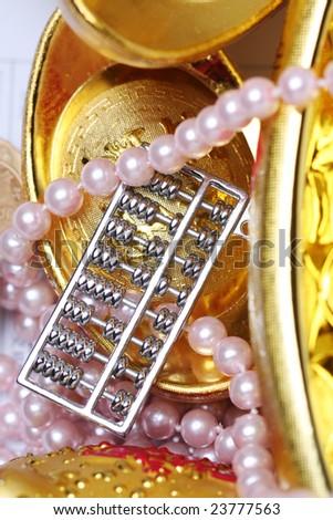 chinese gold ingots and jewelry - stock photo