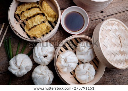 Chinese Steamed Dumplingin and buns bamboo basket