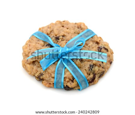 chocolate cookies tied with blue ribbon isolated on white background  - stock photo