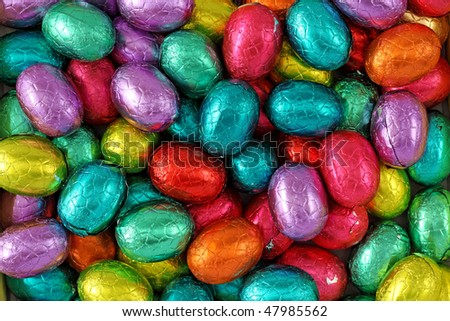 Chocolate eggs in foil close up - stock photo