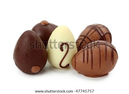 Chocolate eggs isolated on white background - stock photo