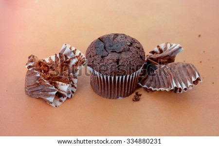 chocolate muffin on wood background