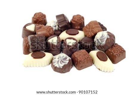 Chocolates candy assortment on a white background - stock photo