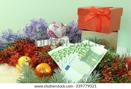 Christmas and New Year  is  time to spend money gift with money  one hundred Euro bank    - stock photo