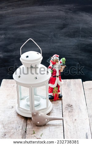Christmas decoration/Candle lighting in a white candle holder. - stock photo