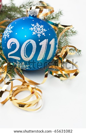 2011 Christmas decorations and fir tree branches - stock photo