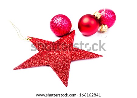 Christmas Decorations isolated on white backhround. Festive Red Star and red balls close up with copy space for greeting text. - stock photo