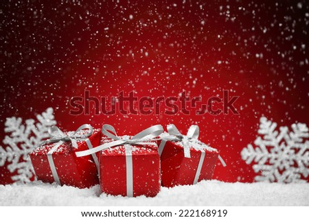 Christmas gift box on snow. - stock photo