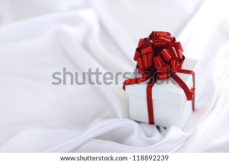 christmas gift on white silk background