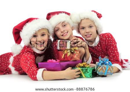 christmas girls with present boxs on white - stock photo