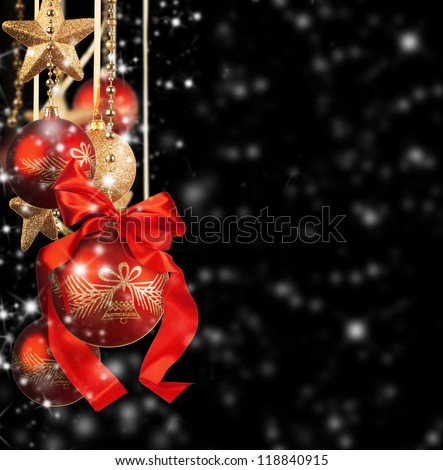 Christmas theme with red glass balls on black background - stock photo