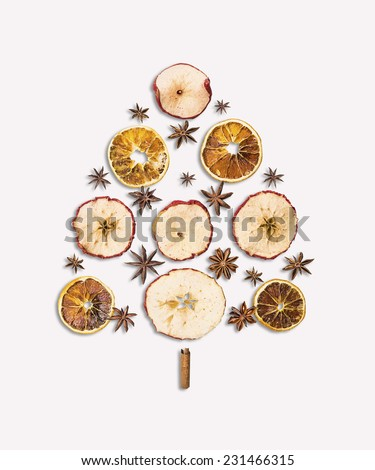 christmas tree Dry fruits and spice on white background - stock photo