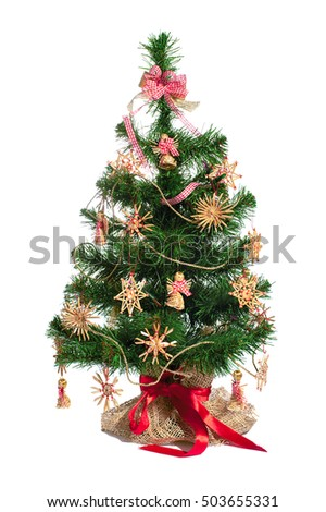 Christmas tree with straw toy decoration isolated on white background