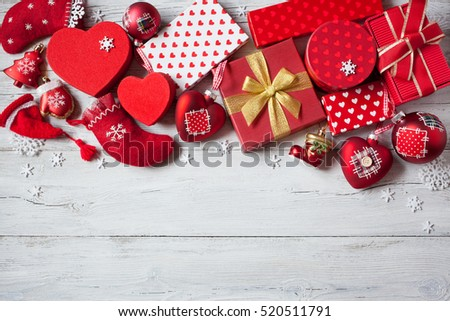 Christmas wooden background with presents in red boxes, socks and decorations