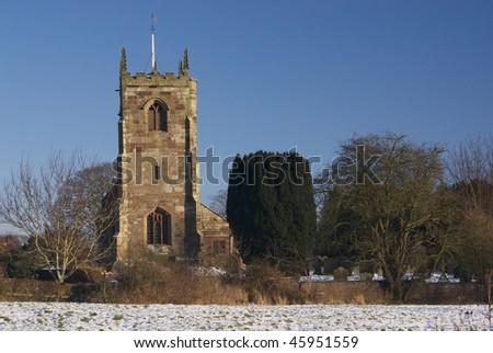 Church and churchyard in snow, Winter view of Staffordshire village church
