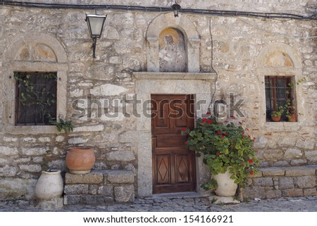 church entrance with flowerpots