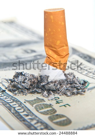 cigarette butt laying on money